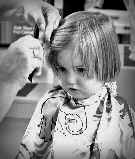 Hairdresser and child
